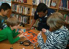 Sulaiman and iRobotics run a Lego Robotics workshop for students at Yankee Ridge Elementary School.