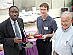 CNST director Ilesanmi Adesida (left) socializes with mechanical engineering professor Mark Shannon (center) and materials science professor James Economy