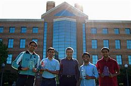 Qualcomm contest winners (from left) Sreeram Kannan, Adnan Raja, Professor Venu Veeravalli (faculty adviser), Sreekanth Annapureddy, and Jayakrishnan Unnikrishnan.