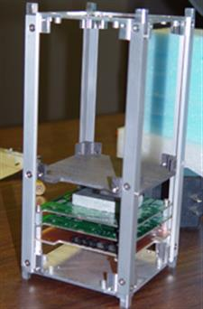 A partial assembly of the ION 2 satellite prototype with three circuit boards assembled at the bottom.