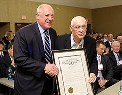 Illinois Governor Pat Quinn (left) presented Nick Holonyak Jr. with the proclamation declaring October 24, 2012, to be Nick Holonyak Day in Illinois.