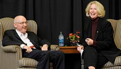 Nick Holonyak Jr. (left) and Moira Gunn shara a laugh during their interview held as part of the lunch program on October 24.