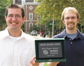 Joshua Wood (left) and Justin Koepke tied for the Best Paper Award at the at 2009 IEEE International Conference on Nanotechnology.