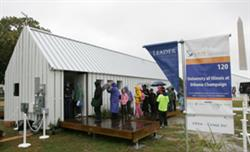 Visitors braved the rain to visit the Solar Decathlon houses. Photo by Stefano Paltera/U.S. Department of Energy Solar Decathlon.