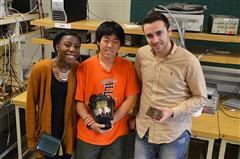 The senior design team (L-R)—Lauren White, Hyun Yi, and Andri Teneqexhi—with the two components of their thermal sensing device.