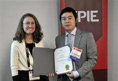 ECE graduate student Yi Chen at the presentation for the SPIE Best Student Paper in Advanced Fabrication. With  session chair Dr. Theresa Mayer. (Photo courtesy of SPIE.)