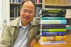 Jianming Jin with books he's authored, including the most recent at top.