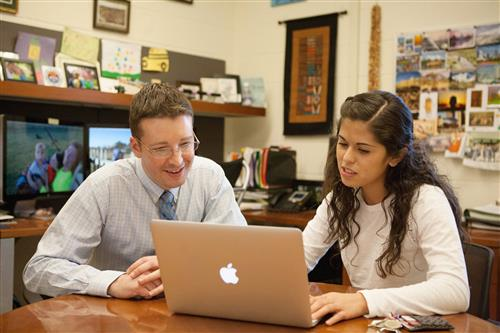 Assistant Professor Jeremy Guest, left, works with then-CEE student Amanda Lardizabal (MS 16, PhD 17)